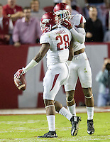 NWA Democrat-Gazette/JASON IVESTER <br /> Arkansas defensive back Santos Ramirez (9) (right) celebrates with Arkansas defensive back Josh Liddell (28) following Liddell's interception during the second quarter on Saturday, Oct. 10, 2015, at Bryant-Denny Stadium in Tuscaloosa, Ala.