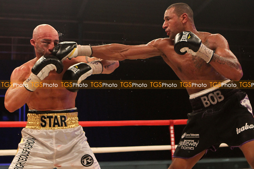 Dean Francis vs Bob Ajisafe in a boxing contest at the Rivermead Leisure Centre, Reading, promoted by Hennessy Sports - 16/03/14 - MANDATORY CREDIT: Chris Royle/TGSPHOTO - Self billing applies where appropriate - 0845 094 6026 - contact@tgsphoto.co.uk - NO UNPAID USE
