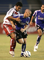 14 May 2005:  Carlos Ruiz of FC Dallas battles for the ball against Wade Barrett of Earthquakes during the second half of the game at Spartan Stadium in San Jose, California.   Earthquakes tied FC Dallas, 0-0.  Credit: Michael Pimentel / ISI