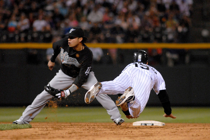 03 July 2008: Colorado Rockies outfielder Ryan Spilborghs slides into 2nd base during a successful steal against the Florida Marlins. Covering 2nd base is Marlins 2nd baseman Alfredo Amezaga. The Rockies defeated the Marlins 6-5 in 11 innings at Coors Field in Denver, Colorado.