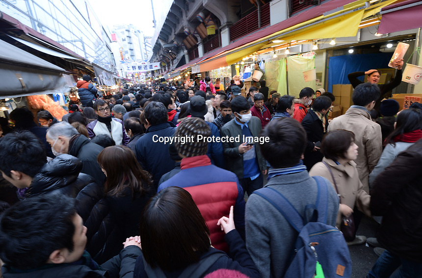 Ameyoko Market in Ueno district of Tokyo, Japan is abuzz on New Year's Eve as people buy fresh seafood for their New Year's feast.  The Japanese celebrate the coming on the New Year with a feast and a visit to the temple.   Picture by Richard Jones