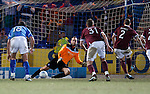 Jamie Hamill sends keeper Alan Mannus the wrong way as Hearts score a last gasp penalty to equalise and take the game into extra time