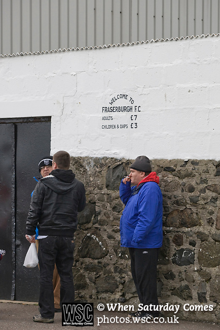 Supporters forming a queue at the turnstile at Bellslea Park, home of Fraserburgh FC, prior to the club's Highland League fixture against visitors Strathspey Thistle. Nicknamed 'The Broch,' Fraserburgh have been members of the Highland League since 1921 having been formed 11 years earlier. The match ended in a 2-2 draw in front of a crowd of 302.