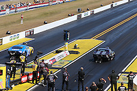 Mar. 16, 2013; Gainesville, FL, USA; NHRA pro mod driver Mike Castellana (right) races alongside Mike Janis during qualifying for the Gatornationals at Auto-Plus Raceway at Gainesville. Mandatory Credit: Mark J. Rebilas-