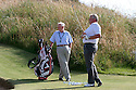 SOUTHPORT, ENGLAND - JULY 26:  Colin Montgomerie of Scotland on the practice area with his father James Montgomerie after the second round of The Senior Open Championship played at Royal Birkdale Golf Club on July 26, 2013 in Southport, United Kingdom.  (Photo by Phil Inglis/Getty Images)