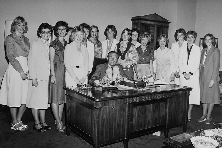 Rep. Guy Vander Jagt, R-Mich., with women staff members in his office. (Photo by CQ Roll Call)