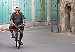 A man rides a bike in the Zeitoun neighborhood of Gaza City, Gaza. Residents of the Palestinian territory are still reeling from the death and destruction of the 2014 war with Israel, and the continuing siege of the seaside territory by the Israeli military.