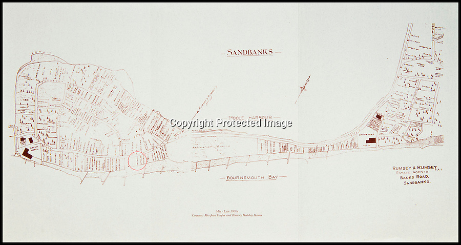 BNPS.co.uk (01202 558833)<br /> Pic: IrisMorris/BNPS<br /> <br /> Properties that had sprung up by the 1930s on Sandbanks. Hook Sands is circled. <br /> <br /> A humble holiday home a family bought for just £1,000 almost a century ago on the exclusive enclave of Sandbanks has turned into a luxury property now worth £5 million.<br /> <br /> The bungalow was bought new by Dr Edward Andreae in the 1920s when the practice of building on the sandy Dorset peninsula was questioned because of perceived issues over stability.<br /> <br /> Over the last seven decades the bolthole has been passed down through the generations of the same family until it fell into a state if disrepair.<br /> <br /> In 2011 Dr Andreae's great-grandson, Tim Baldwin, and his father Jonathan, made the drastic decision to demolish the 90 year old building and erect a new one in its place.<br /> <br /> They spent 580,000 pounds creating a luxurious beach escape on the 'Millionaires' Row' in Poole Harbour.<br /> <br /> The plot is now home to a sprawling seven bedroom, five bathroom property which experts believe to be worth around five million pounds - 5,000 times it's original purchase price.