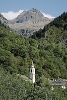 Switzerland. Canton of Ticino. Val di Blenio (Blenio valley). Village of Dangio. Catholic church. Bell tower. Pian Premesti mountain. © 2006 Didier Ruef