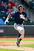 Lane Adams (6) of the Wilmington Blue Rocks hustles down the first base line against the Winston-Salem Dash at BB&T Ballpark on April 21, 2013 in Winston-Salem, North Carolina.  The Blue Rocks defeated the Dash 5-3.  (Brian Westerholt/Four Seam Images)