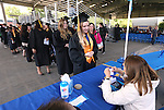 Cira Craighead checks in before the 45th annual Western Nevada College Commencement ceremony in Carson City, Nev., on Monday, May 23, 2016. A record 556 graduates received 598 degrees.<br />