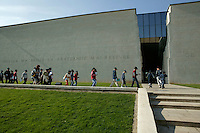 "25 April 2004 - Caen, France - Schoolchildren arrive at the Memorial museum in Caen, France, 25 April 2004. The text on the wall reads: ""pain broke me down fraternity picked me up""."