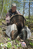 Hunter with wild turkey