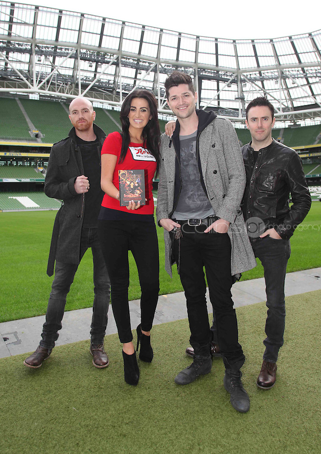 "NO REPRO FEE: 1.12.2011: Irish trio The Script pictured at the Aviva Stadium Dublin to mark the release of their first concert DVD ""HOMECOMING: LIVE AT THE AVIVIA STADIUM DUBLIN"" filmed by acclaimed director Dick Carruthers ( Oasis, White Stripes, Paul McCartney.) 98FM's Thunder Trio Jeri Mahon, Mary Scott and Angela Frawley joined band members Danny, Mark and Glen reliving the experience of playing on home turf to a 54,000 strong crowd! The Script were back in Dublin earlier this year on July 2nd  to play the sold-out show, the event that marked the pinnacle of the band's career to date coming just 3 years after their 1st gig at Dublin's Sugar Club in front of 28 people. The DVD is of the entire concert, includes their hits ""The Man Who Can't be Moved"", ""Nothing"" and ""Breakeven."" Pictured (l-r) at the DVD launch was 98FM's Thunder Angela Frawley with Script band members Glen Power, Danny O'Donoghue and Mark Sheehan. Picture Collins."