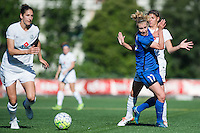 Seattle, WA - Sunday, May 1, 2016: Seattle Reign FC forward Beverly Yanez (17) pushes off  FC Kansas City defender Brittany Taylor (13) as FC Kansas City midfielder Yael Averbuch (10) moves the ball during a National Women's Soccer League (NWSL) match at Memorial Stadium.