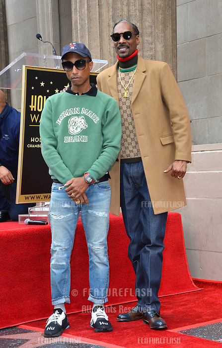 LOS ANGELES, CA. November 19, 2018: Snoop Dogg &amp; Pharrell Williams at the Hollywood Walk of Fame Star Ceremony honoring Snoop Dogg.<br /> Pictures: Paul Smith/Featureflash