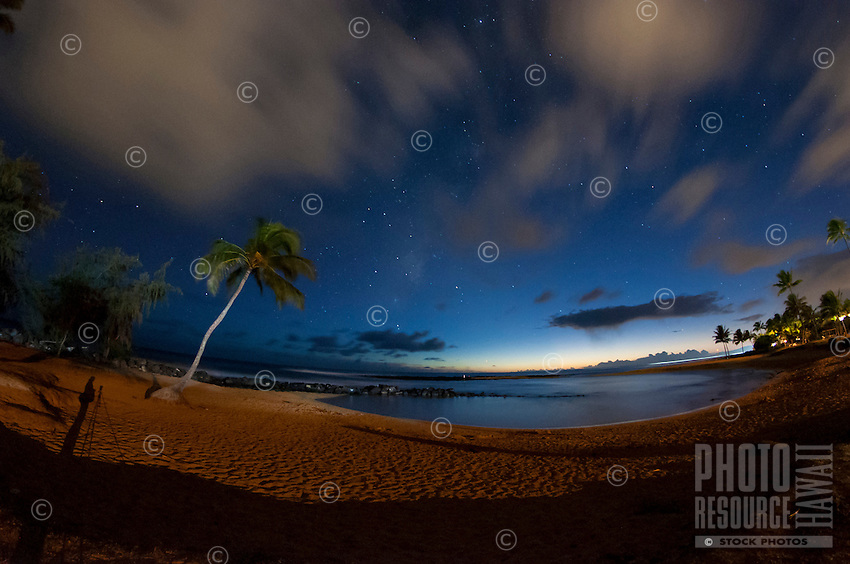 The hint of a sunset afterglow on the wane, revealing the blue of a star-studded night sky at family friendly Brennecke's Beach, Poipu, Kauai.