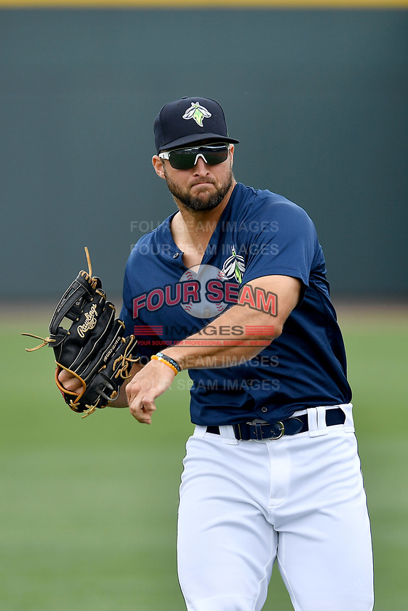 Left fielder Tim Tebow (15) of the Columbia Fireflies warms up before a game against the Lexington Legends on Sunday, April 23, 2017, at Spirit Communications Park in Columbia, South Carolina. Lexington won, 4-2. (Tom Priddy/Four Seam Images)