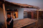 A neighborhood bar at dusk on Saturday, Apr. 18, 2009 in Ventanilla, Peru.