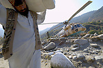 Following an October 8, 2005, earthquake in Pakistan, international relief groups responded quickly to the needs of thousands of affected families. Here a Pakistan Army helicopter is used to ferry relief supplies, provided by Church World Service/Action by Churches Together, to people in the remote village of Banna. The quake measured 7.6 on the Richter scale and killed more than 74,000 pople in northern Pakistan.