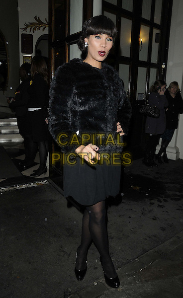 Javine Hylton.The 'Spamalot' press night, Playhouse Theatre, Northumberland Avenue, London, England..November 20th, 2012.full length black fur jacket tights dress  .CAP/CAN.©Can Nguyen/Capital Pictures.