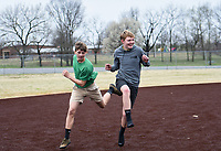 Keaton Harris, 15, of Bentonville (from left) and Hayden Brewer, 14, of Bentonville play baseball, Monday, March 16, 2020 during a baseball game at the Memorial Park ball field in Bentonville. Check out nwaonline.com/200317Daily/ for today's photo gallery.<br /> (NWA Democrat-Gazette/Charlie Kaijo)