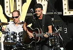 LOS ANGELES, CA. - April 28: Musiciain/singer Mark Ballas  performs during the World Wish Day Celebration With Miley Cyrus at The Grove on April 28, 2010 in Los Angeles, California.