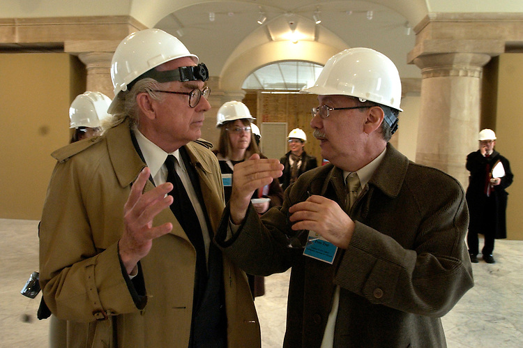 Tony Harvey of The InTowner, left, talk with Marc Pachter, director of the National Portrait Gallery, during a tour of the museum and the Smithsonian American Art Museum that is scheduled to open July 1, 2006, after a six year renovation project.