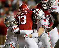 Ohio State Buckeyes cornerback Jordan Fuller (4) and defensive end Sam Hubbard (6) tackle Rutgers Scarlet Knights running back Gus Edwards (13) during the first quarter of the NCAA football game at Highpoint Solutions Stadium in Piscataway, New Jersey on Sept. 30, 2017. [Adam Cairns / Dispatch]
