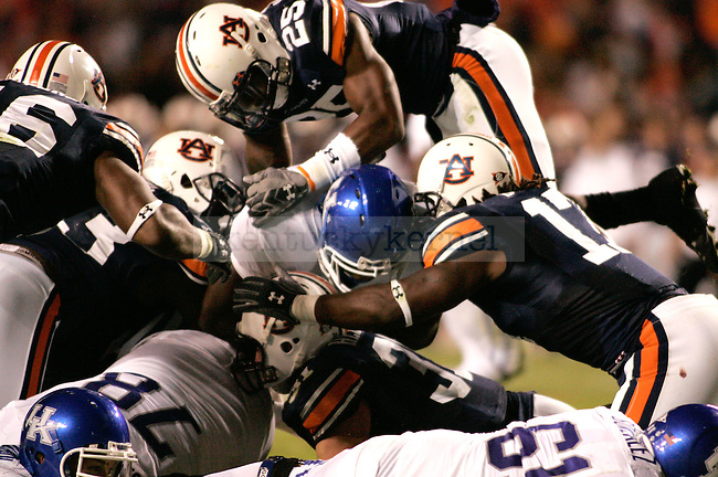 UK fullback John Conner pushes through  the Auburn defense in the first half of the game at the Jordan-Hare Stadium Saturday. The Cats won 21-14..Photo by Zach Brake | Staff
