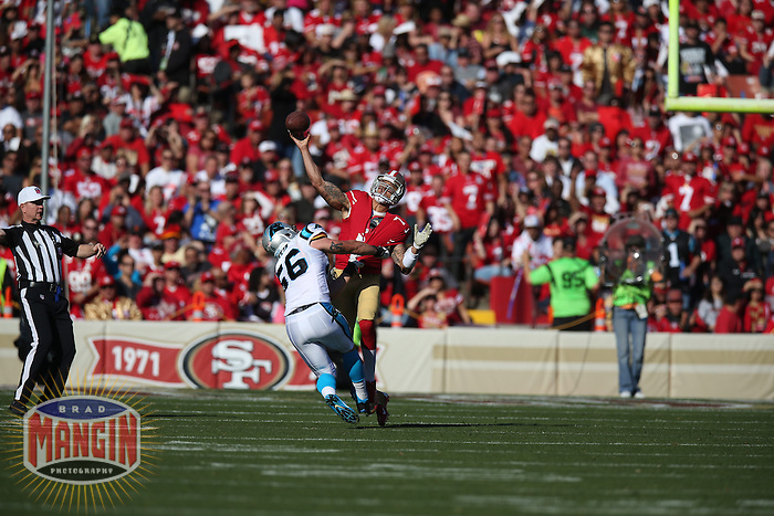 SAN FRANCISCO, CA - NOVEMBER 10:  Colin Kaepernick #7 of the San Francisco 49ers is grabbed by A.J. Klein #56 of the Carolina Panthers during the game at Candlestick Park on November 10, 2013 in San Francisco, California. (Photo by Brad Mangin)