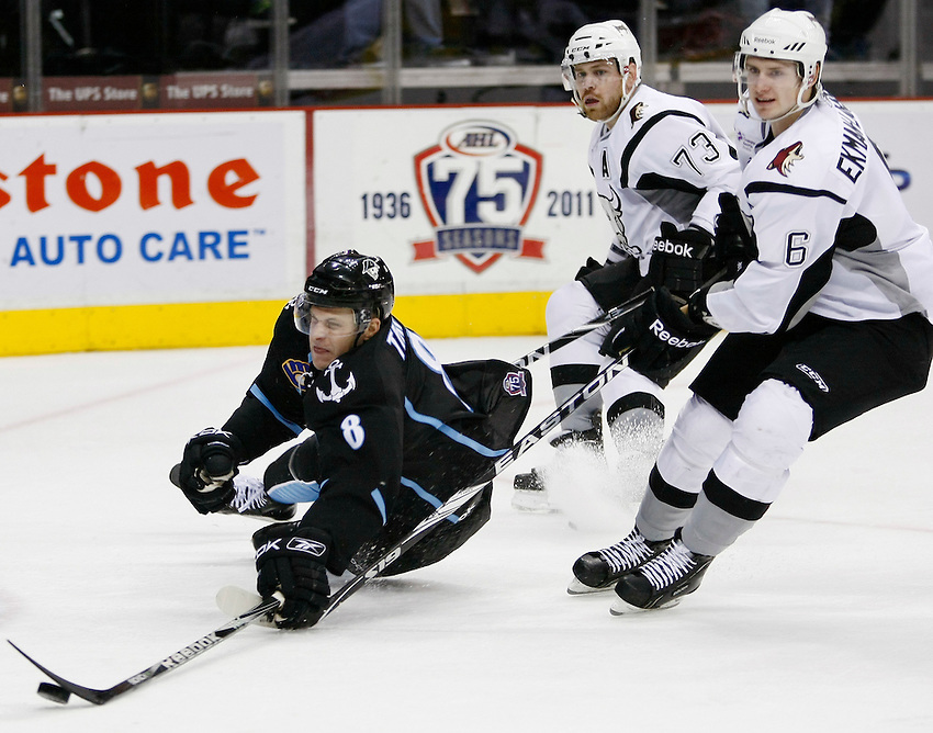 Milwaukee Admirals' Ryan Thang, left, is taken down by San Antonio Rampage's Oliver Ekman-Larsson, right, and Garrett Stafford during an AHL hockey game, Friday, Nov. 19, 2010, at the AT&T Center in San Antonio. San Antonio won 4-3 in a shootout. (Darren Abate/pressphotointl.com)