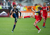 22 October 2011: New England Revolution forward Monsef Zerka #19 and Toronto FC midfielder Terry Dunfield #23 in action during a game between the New England Revolution and Toronto FC at BMO Field in Toronto..The game ended in a 2-2 draw.