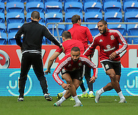 CARDIFF, WALES - SEPTEMBER 05: Ashley Jazz Richards (C) and Ashley Williams (R) warm up during the Wales training session, ahead of the UEFA Euro 2016 qualifier against Israel, at the Cardiff City Stadium on September 5, 2015 in Cardiff, Wales.