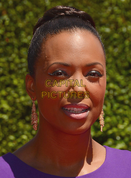 16 August 2014 - Los Angeles, California - Aisha Tyler. Arrivals for the 2014 Creative Arts Emmy Awards held at Nokia Theater L.A. LIVE in Los Angeles, Ca.  <br /> CAP/ADM/BT<br /> &copy;Birdie Thompson/AdMedia/Capital Pictures