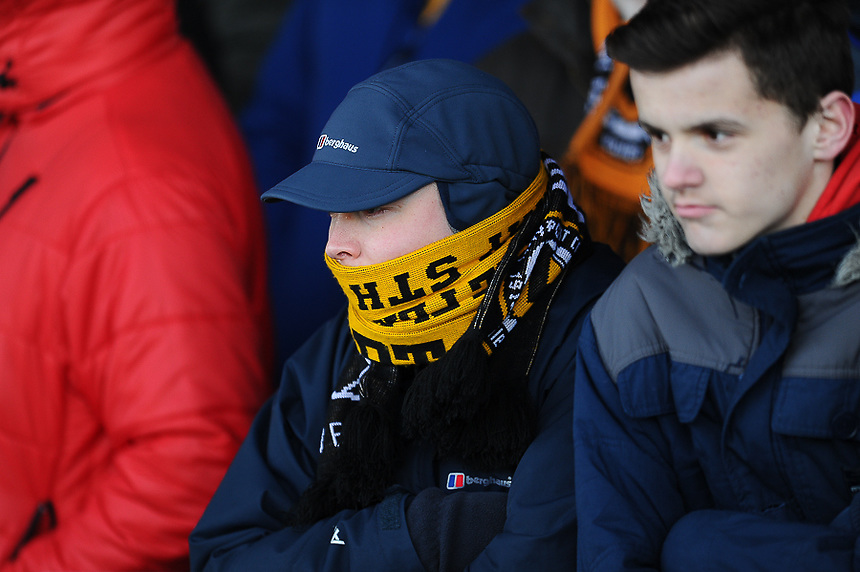 A Newport county fans keeps warm ahead of todays game against Shrewsbury Town<br /> <br /> Photographer Craig Thomas/CameraSport<br /> <br /> Football - The Football League Sky Bet League Two - Newport County v Shrewsbury Town - Saturday 31st January 2015 - Rodney Parade - Newport<br /> <br /> &copy; CameraSport - 43 Linden Ave. Countesthorpe. Leicester. England. LE8 5PG - Tel: +44 (0) 116 277 4147 - admin@camerasport.com - www.camerasport.com