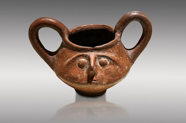 Hittite terra cotta double handled jug with a relief human face- 17th - 16th century BC - Hattusa ( Bogazkoy ) - Museum of Anatolian Civilisations, Ankara, Turkey. Against gray background