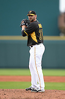 Pitcher Josh Kinney (27) of the Pittsburgh Pirates during a spring training game against the New York Yankees on February 26, 2014 at McKechnie Field in Bradenton, Florida.  Pittsburgh defeated New York 6-5.  (Mike Janes/Four Seam Images)