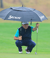 Gonzalo Fernandez-Castano (ESP) on the 1st green during Thursday's Round 1 of the 2014 BMW Masters held at Lake Malaren, Shanghai, China 30th October 2014.<br /> Picture: Eoin Clarke www.golffile.ie