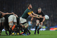 Duane Vermeulen of South Africa passes in front of Kieran Read of New Zealand during the Semi Final of the Rugby World Cup 2015 between South Africa and New Zealand - 24/10/2015 - Twickenham Stadium, London<br /> Mandatory Credit: Rob Munro/Stewart Communications