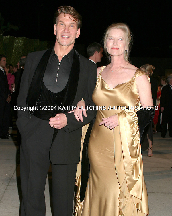 ©2004 KATHY HUTCHINS /HUTCHINS PHOTO.VANITY FAIR OSCAR PARTY.MORTONS RESTAURANT.WEST HOLLYWOOD, CA .FEBRUARY 29, 2004 ..PATRICK AND LISA SWAYZE