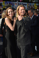 Angelina Jolie, Brad Pitt<br /> 'World War Z' world premiere, Empire cinema, Leicester Square, London, England 2nd June 2013 <br /> half length black dress suit goatee facial hair couple smiling <br /> CAP/PL<br /> &copy;Phil Loftus/Capital Pictures /MediaPunch ***NORTH AND SOUTH AMERICAS ONLY***