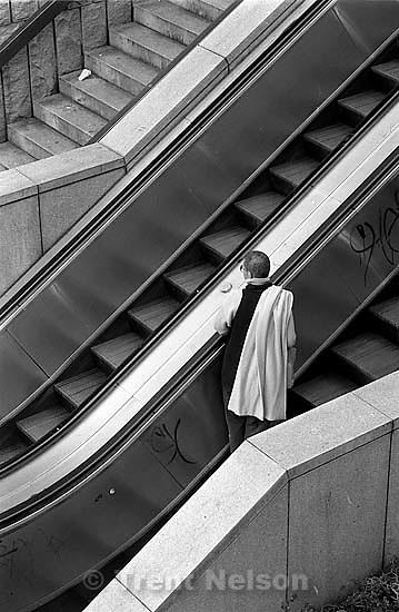 Man on escalator<br />
