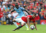 Marcus Rashford of Manchester United tackled by Bacary Sagna of Manchester City during the Premier League match at Old Trafford Stadium, Manchester. Picture date: September 10th, 2016. Pic Simon Bellis/Sportimage