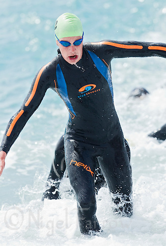 24 APR 2011 - NICE, FRA - Alistair Brownlee (Sartrouville) leaves the water at the end of the swim at the  first round of the 2011 French Grand Prix triathlon series in Nice, France .(PHOTO (C) NIGEL FARROW)