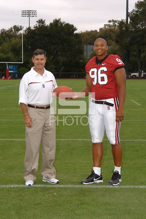 7 August 2006: Stanford Cardinal head coach Walt Harris and Derek Hall during Stanford Football's Team Photo Day at Stanford Football's Practice Field in Stanford, CA.