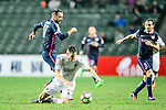 Auckland City Defender Marko Dordevic (C) battles with Rufino Segovia of SC Kitchee (L) during the Nike Lunar New Year Cup 2017 match between SC Kitchee (HKG) and Auckland City FC (NZL) on January 31, 2017 in Hong Kong, Hong Kong. Photo by Marcio Rodrigo Machado / Power Sport Images