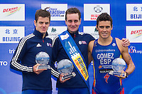10 SEP 2011 - BEIJING, CHN - Alistair Brownlee (GBR) (centre) celebrates winning the 2011 Elite Mens ITU World Championship Series title with runners up Jonathan Brownlee (GBR) (left) and Javier Gomez (ESP) (right) (PHOTO (C) NIGEL FARROW)