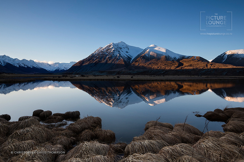 A hidden gem in the Mackenzie District near Omarama is the Ahuriri Conservation Area, one of landscape photographer Christopher David Thompson's best places to shoot - he often hikes there in all seasons to explore and capture the wonders of the Ahuriri River valley and the Ben Avon wetlands.