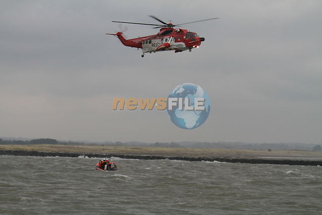 Drogheda Coast Guard Boat and EI-SAR on exercise at the mouth of the river boyne in force 8-10 South Easterly. Two Wet Winches for the chopper.Picture Fran Caffrey/Newsfile.ie